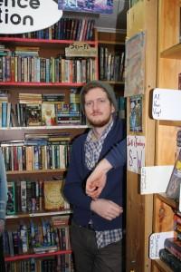 Tyler Smith amongst books
