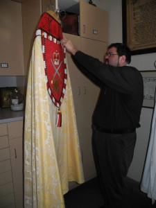 Bill Cliff inspects robes