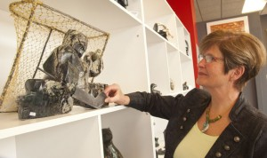 Janet Evans examines a sculpture of a hockey goaltender.