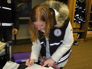 Foot Patrol volunteer Page Boudry signs out at the end of her shift   Photo by Andrea Smith