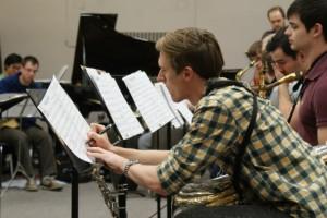 Saxophonist David Stewart edits to his sheet music during jazz practice.