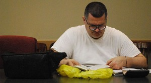 Grit Uplifted writer Dan Lenart reads from a tattered copy of A Handbook to Literature during a recent meeting