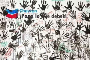 """""""Chevron: Pay What You Owe"""" - Poster part of Chevron's Dirty Hand Campaign   Photo courtesy of the Committee in Solidarity with the Indigenous People of Ecuador Affected by Chevron"""