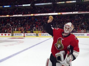 Sens goalie Andrew Hammond skates off with a burger after a recent victory.
