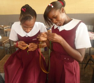 CHANCES provides basic school necessities to children in Jamaica like these two young girls in art class.  Photo courtesy of D'Lenney Grant.