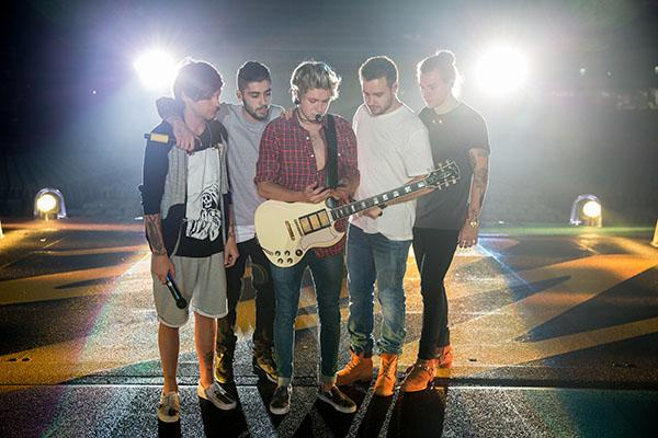 One Direction pictured at one of their concerts in March during their Asian tour.  Pictures from left to right: Louis, Zayn, Niall, Liam, and Harry.   Photo Courtesy of One Direction Twitter page