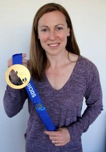 Jayna Hefford holding her 2014 Gold Medal