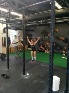 Jenn Lymburner lifts a 55-pound barbell.