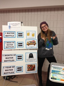Mackenzie Coombe of Envirowestern, enthusiastically poses with the Western Water Week display. (Photo: Emily McWilliams)
