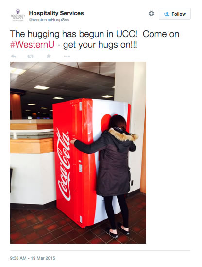 A student gives some love to the coke machine Photo courtesy of Hospitality Services Twitter Page