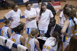 Angela Tilk (second from the left, standing) listens to Charles Kissi talk to his team during a time-out at Ryerson University.