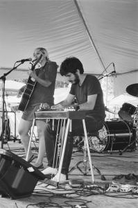 Olenka Krakus and Simon Larochette play an outdoor festival gig together.