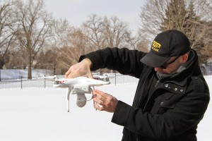 Jeff Owens checks out his drone before takeoff at Harris Park. Photo courtesy of Amy Legate-Wolfe