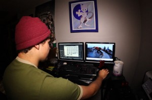 Groves editing some past clips. He says this improvement in everyday technology has given urban snowboarding a major boost. Photo courtesy of Jordan Groves.
