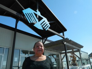 Traditional healer Liz Akiwenzie sits under the Thunderbird symbol at the Chippewas of the Thames S.O.A.H.A.C. site.