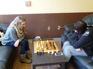 Jenny Mayer and Jessica Cooper come to board game cafés for an experience that differs from a bar or coffee shop. Photo courtesy of Allan McKee