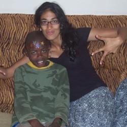 Supriya poses with a Tanzania child.