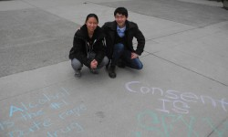 Jessica Tong and Alex Lu volunteer for I Know Someone at Western University.