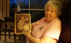 Joan Johnston holds a portrait of four of six children she raised with husband Ron.