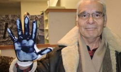 A Canadian man displays his oil-covered glove used in the Dirty Hand Campaign against Chevron. <br /> Photo courtesy of the Committee in Solidarity with the Indigenous People of Ecuador Affected by Chevron <br />