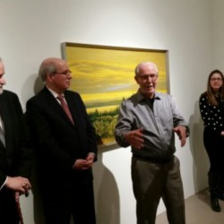 "Maurice Stubbs, right, speaking at the opening for his exhibit ""Primary Forces,"" at the McIntosh Gallery. Photo: Sara Mai Chitty"