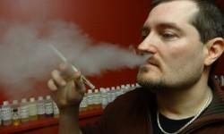 Craig Smith smoking an e-cigarette