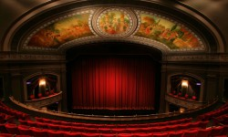 An empty stage at the Grand Theatre in London, which celebrates World Theatre Day today.