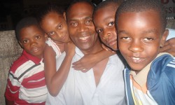 D'Lenney Grant, centre, travels to Jamaica every two months to visit and provide for his 250 sponsored children. <br />