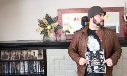 Bad Idea Comedy co-founder Matt Ker shows off his première show poster.<br /> Photo by Mason Zimmer.<br />